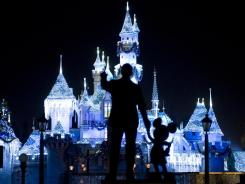 Disneyland's iconic 'Partners' statue, featuring Walt Disney and Mickey Mouse, faces Sleeping Beauty's Winter Castle in Anaheim, Calif. Discounted ticket purchases often carry date restrictions, including weekends, holidays, school breaks and summer months.