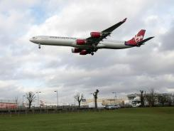 A Virgin Atlantic plane approaches London's Heathrow Airport.