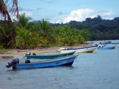 Boats line up outside the Gandoca-Manzanillo National Wildlife Refuge. The refuge is known for its coral reef.