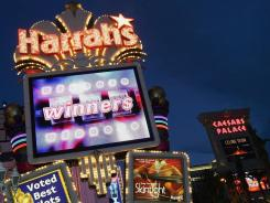 The Harrah's Las Vegas and Caesars Palace marquees on the Strip beckon gamblers in Vegas.