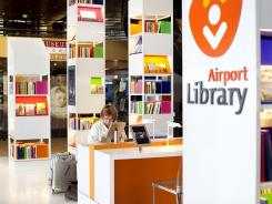 A traveler using the airport library at Schiphol airport in Amsterdam.