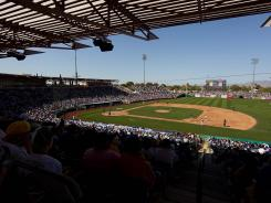 A spring training game takes place between the Cubs and the A's at Hohokam Park in Mesa, Ariz., March 4.