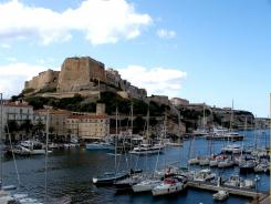Corsica's Bonifacio harbor with the citadel in the background.