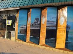 A hand-painted, three-dimensional mural called 'Ludington: Doorway to the Great Lakes' adorns the wall outside Cole's Antiques Villa in Ludington, Mich. The mural by artist Terry Dickinson shows the S.S. Badger, a car ferry whose home port is Ludington.