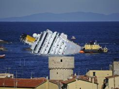 Tthe stricken cruise liner Costa Concordia is shown off the Isola del Giglio in this Jan. 25 photo.