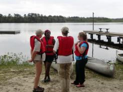 Participants in a 'Becoming an Outdoors-Woman' class get instructions from Kelly Langston in kayaking and canoeing basics on Lake Eaton at the Ocala Conservation Center and Youth Camp in Ocala National Forest, Fla.