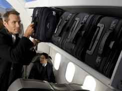 The FAA sets weight limits on overhead bins and during flight testing the airplane is flown with various weight and centers of gravity