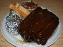 The ribs are excellent, perfectly done with a charred crusty exterior, juicy tender interior, nice bite, smoky flavor, and sauce.
