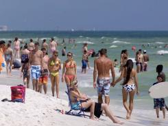 Beachgoers enjoy beautiful weather on the shores of the Gulf of Mexico near Fort Walton Beach, Florida.