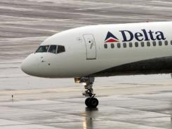 A Delta plane is seen on the ground at Phoenix Sky Harbor International Airport in this file photo.