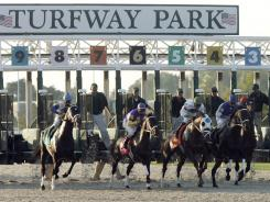 Horses break out of the gate at Turfway Park in Florence, Ky. While tracks in other states have parlayed casino gambling into higher purses, Kentucky lawmakers have resisted allowing such a move.