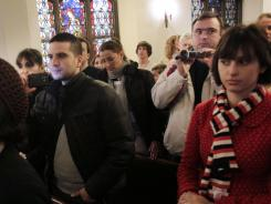 Tourists record video and take photos during a service at the Mother AME Zion Church in New York.