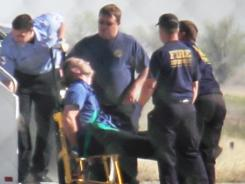 Emergency workers in Amarillo, Texas, tend to a JetBlue pilot subdued by passengers during a Las Vegas-bound flight from JFK Airport on March 27, 2012.