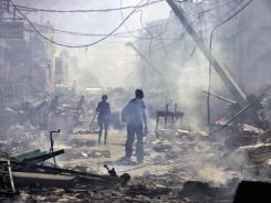 People wander in Port-au-Prince five days after a quake devastated the country on Jan. 12, 2010.