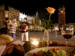 The sidewalk cafes lining Krakow's Main Market Square offer the best seats for taking in the city's street theater.