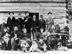 The Hatfield clan poses in April 1897 at a logging camp in southern West Virginia.