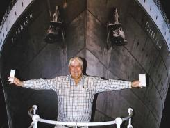Australian billionaire Clive Palmer poses in front of an artist impression of the Titanic ll at MGM Studios in Los Angeles, Ca.