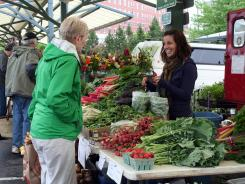 Seasonal produce and flowers are all on the offer at the market in Bloomington, Ind.
