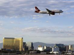 A Virgin America flight prepares to land at Las Vegas McCarran International Airport on March 22, 2012. Passengers can expect planes to be packed this summer as airlines hold down the number of seats available to travelers.