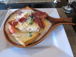Invented in Louisville in 1926, the Hot Brown is an open-faced sandwich of turkey, toast points, Mornay sauce, tomatoes, bacon and pecorino Romano cheese baked in an ovenproof skillet and served bubbling hot.
