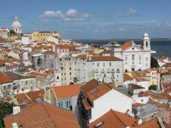 The red-tiled rooftops of Lisbon, Portugal's capital, spill to the banks of the Tagus River where it flows into the Atlantic Ocean.