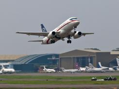 A Sukhoi Superjet 100 takes off on its second demonstration flight of the day at Halim Perdanakusuma airport in Jakarta, Indonesia, on May 9, 2012.