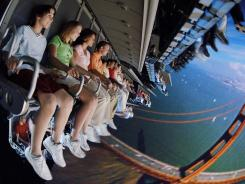 It's difficult to know this summer whether you're getting an airfare deal or being taken for a ride, but following these tips could help you save a bundle and arrive to your dream destination. Here, visitors enjoy the Soarin' ride at Disney World's Epcot park.