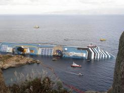 This Jan. 22 photo shows the Costa Concordia on its side off the Tuscan island of Giglio, Italy.