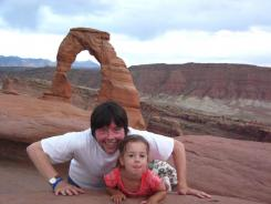 Passing on American birthright: Ken Burns and his daughter Olivia, 4, at Arches National Park in September 2009.