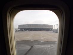 Individual airlines determine whether window shades are up or down during takeoff or landing. They submit a request for FAA approval for the shade position to be included in their safety briefings. Here, a view of Charles DeGaulle Airport in Paris.