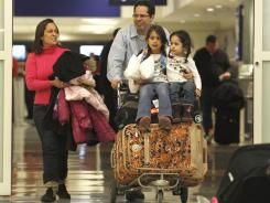 A family walks out of U.S. Customs at Dallas/Fort Worth International Airport in January.