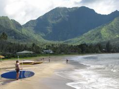 One of Hanalei's best features is arguably its gorgeous backdrop: it is surrounded by verdant mountains, towering cliffs, and pristine beaches.