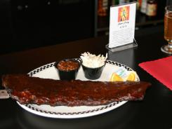 A slab of St. Louis-style pork ribs at Hot Rods will satisfy the pickiest -- and heartiest -- BBQ appetite.
