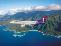 A Hawaiian Airlines plane flies over Hawaii.