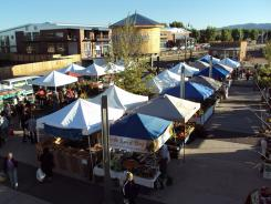 Shoppers find Southwestern peppers and beans and other regional foods at the Santa Fe Farmers Market in New Mexico.