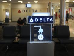 Delta draws attention to extra outlets for electronic devices at Atlanta's Hartsfield-Jackson International Airport.