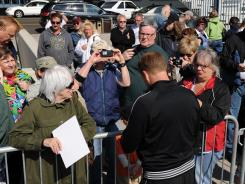 High-wire walker Nik Wallenda signs autographs after a practice session. He plans to walk on a wire stretched over Niagara Falls.
