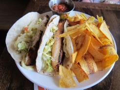 Fish tacos at Winchester means whole slabs of lemongrass coriander-rubbed tilapia with citrus slaw and saffron aioli on flour tortillas from a local Mexican bakery and house-made plantain chips.
