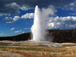 Old Faithful erupts in Yellowstone National Park in Wyoming.