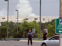 Police block off access to the FAA's William J. Hughes Technical Center in Egg Harbor Township, N.J., during a fire Friday.