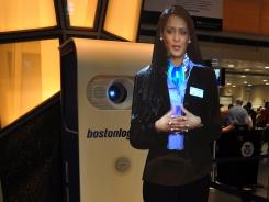 "Travel hologram ""Carla"" offers fliers security advice at Boston Logan airport."