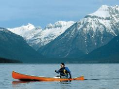 Jon Crandall paddles across Lake McDonald in Glacier National Park.