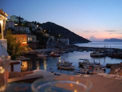 Kodylenia's Taverna in Hydra, Greece marries the charm of Kaminia's port, the bustle of vessels on the water, and the 'beauties of a Greek isle escape,' Steves says.