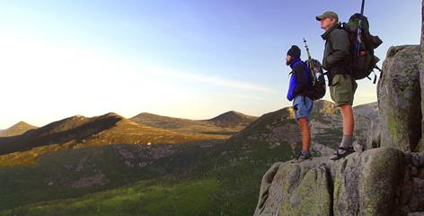 Appalachian Trail thru-hikers pause near the summit of Mount Katahdin to look back at the land they covered after a five-month, 2,155-mile hike, in Maine's Baxter State Park.