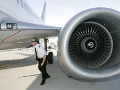 A pilot inspects a plane before takeoff at Cleveland Hopkins International Airport, in 2006.