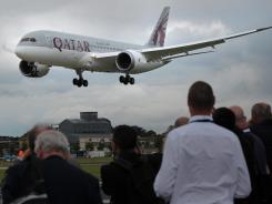 A Qatar Airways Boeing 787 Dreamliner takes part in the Farnborough International Airshow on July 9, 2012. Boeing upstaged rival Airbus with a $7.2 billion order for 75 of its upcoming 737 Max jets.