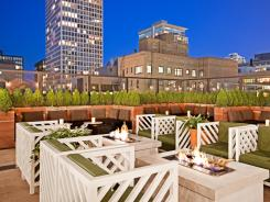 The Drumbar is a new speakeasy-style rooftop lounge at Chicago's Raffaello Hotel.