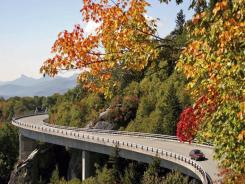 A car passes by fall foliage on the Blue Ridge Parkway at Grandfather Mountain in Linville, N.C.