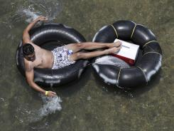 A tuber floats down the Comal River in New Braunfels, Texas.