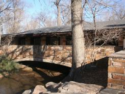 Idyllic setting: A stream flows under the nature center at the recreation area.